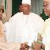 Tinubu, Oyegun shake hands at Buhari's book launch