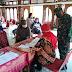 Babinsa Kepatihan Wetan Amankan Penyaluran Bantuan Sosial Tunai Kepada Masyarakat Terdampak Covid19