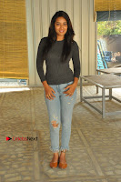 Actress Bhanu Tripathri Pos in Ripped Jeans at Iddari Madhya 18 Movie Pressmeet  0044.JPG