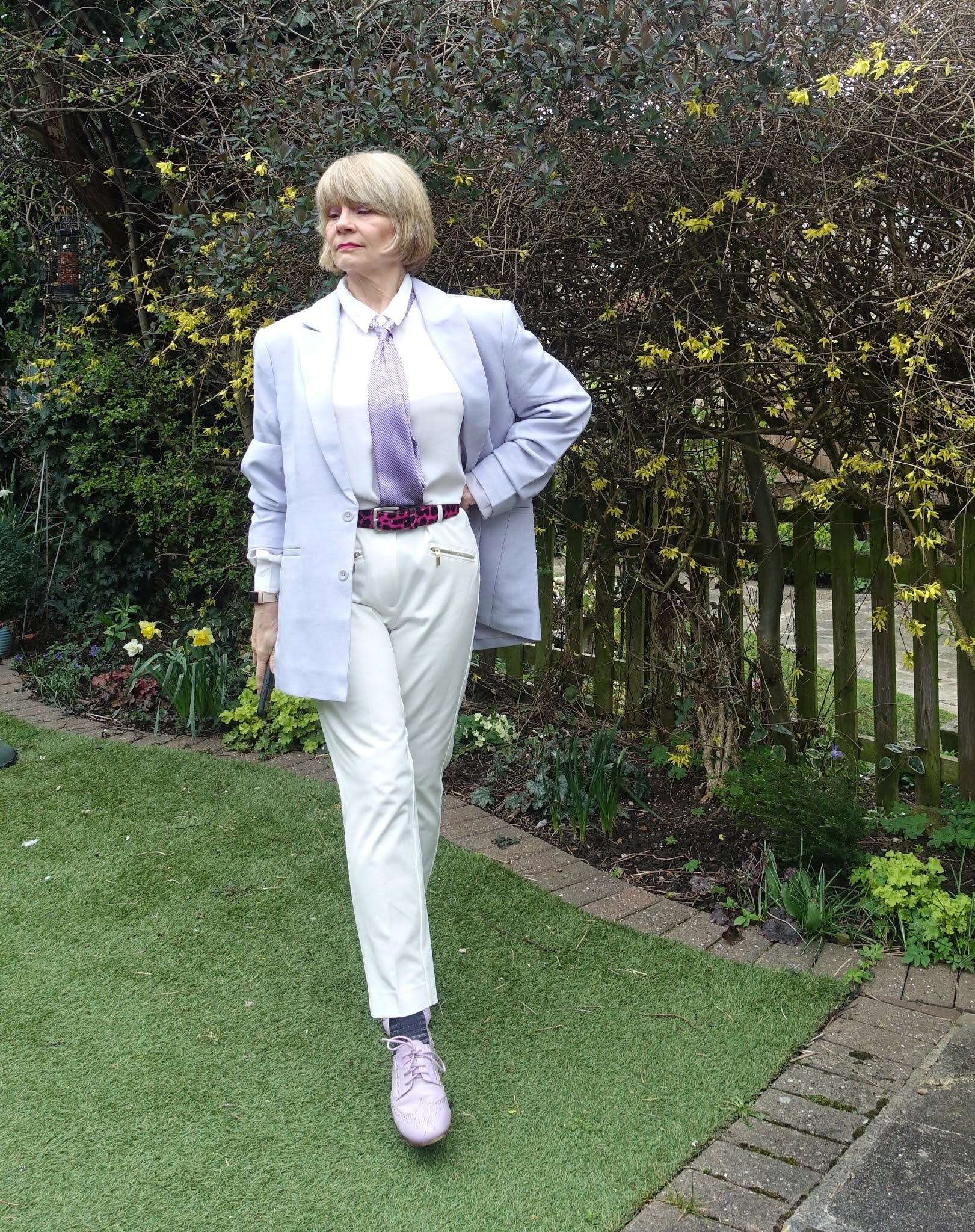 An androgynous look with a unisex lilac jacket, white trousers, lilac tie and brogues from Is This Mutton, the style blog for the over 50s