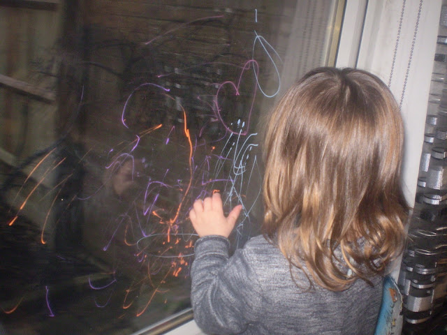 Eldest decorating a window