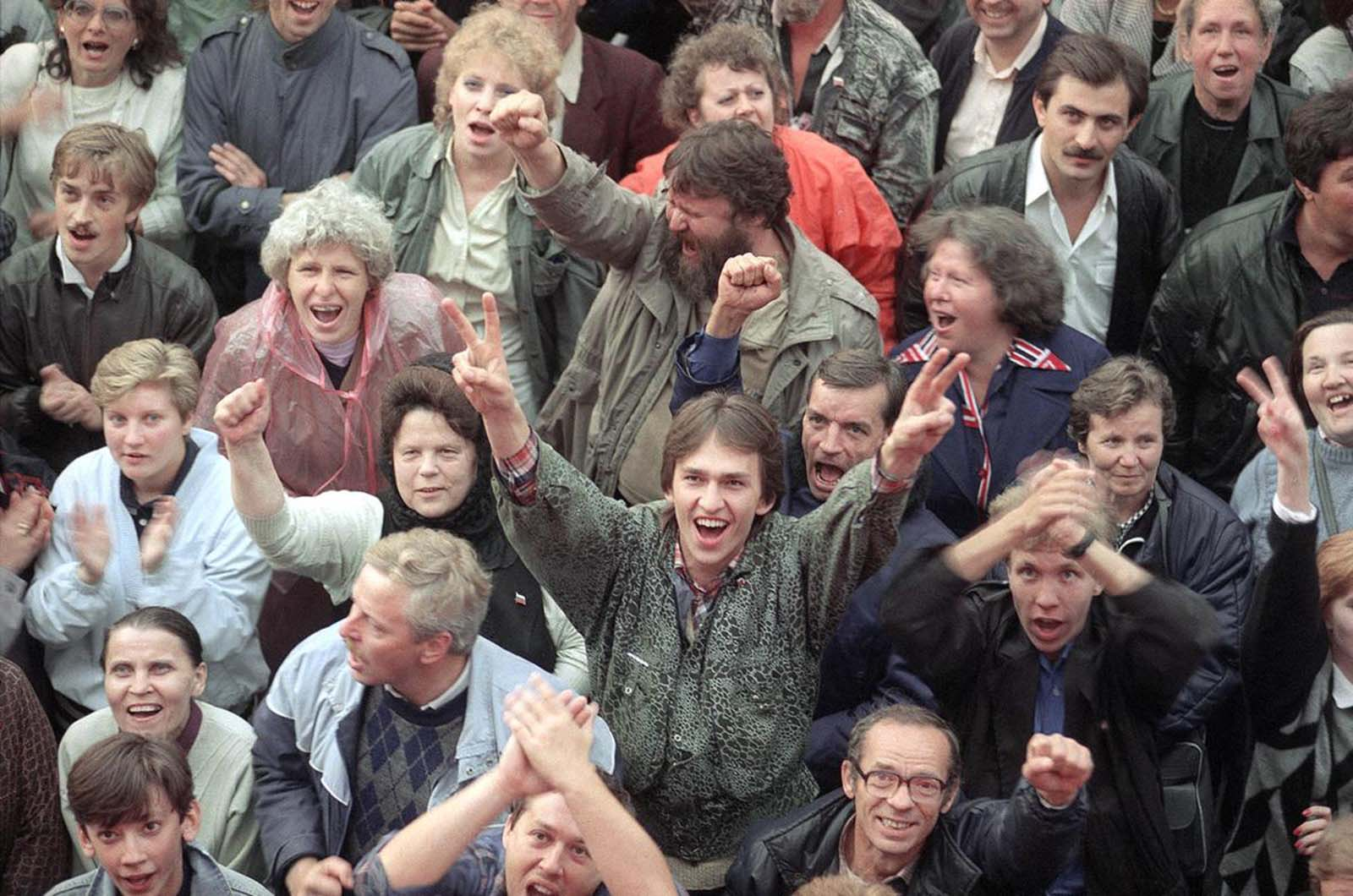 Part of a large crowd, outside the Russian Parliament building in Moscow, celebrates the news that the hardline Communist coup has failed, on August 22, 1991.