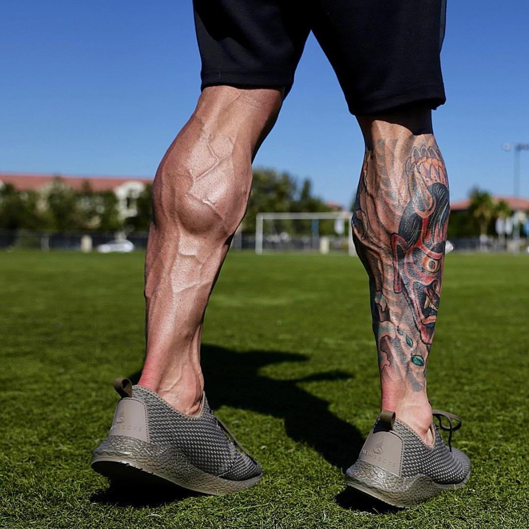 strong-veiny-male-legs-tattoo-parker-egerton-football-field-players