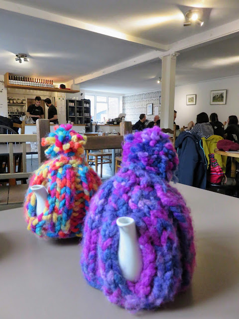Knitted tea cosies at the Warehouse Cafe in Birmingham, England