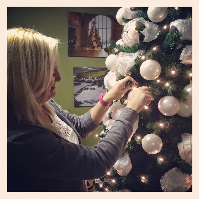 madmumof7 with long blonde hair decorating christmas tree