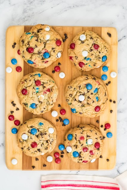 cookies on a wooden board with m&m's