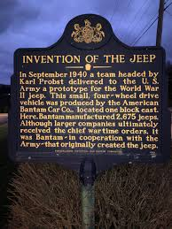 Blue and gold state historical marker - title reads The Invention of the Jeep