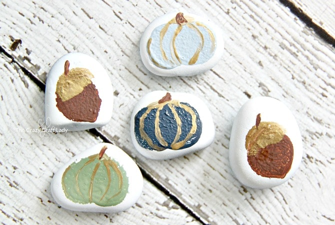 Fall inspired pumpkin and acorn painted rocks