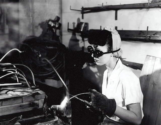 A woman welding in a workshop