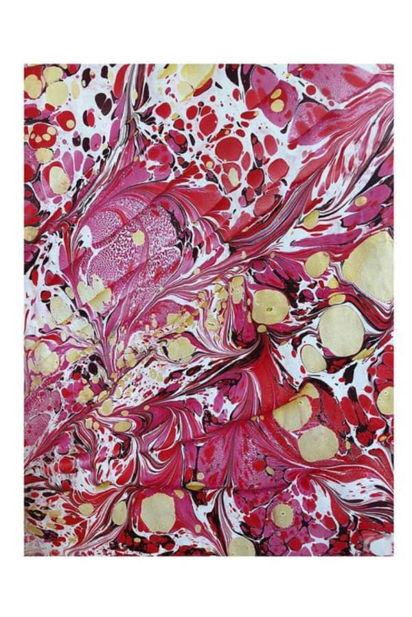 red, white and gold marbled paper sheet