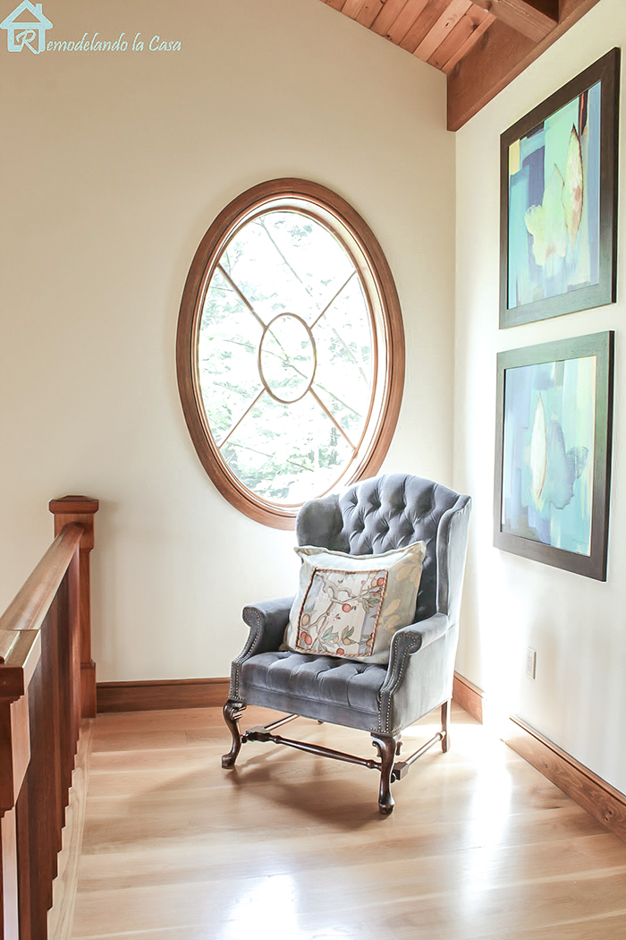 round window and comfy chair
