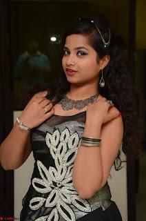 Shrisha Dasari in Sleeveless Short Black Dress At Follow Follow U Audio Launch 036.JPG