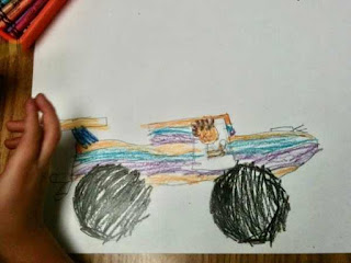 kindergarten drawing of a vehicle with wheels