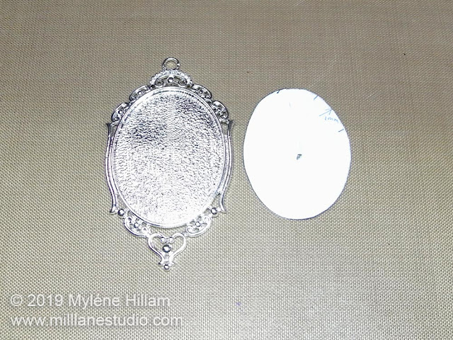 Ornate silver bezel and paper template sized to fit