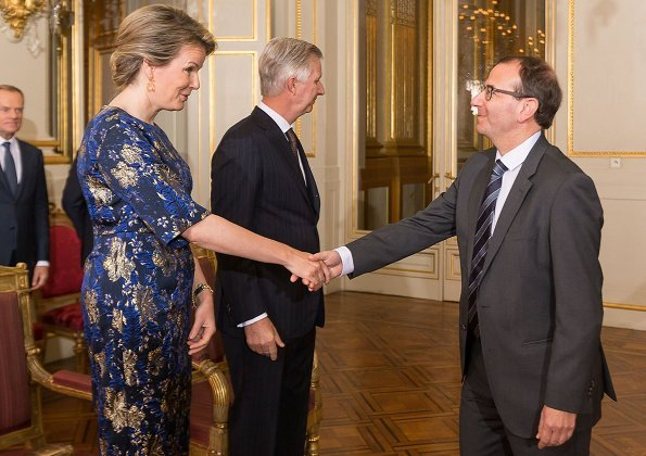 Queen Mathilde wore Dries Van Noten A-Line metallic floral jacquard midi dress. European Union, and the foreign diplomats
