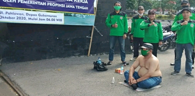 Kecewa Sikap Ganjar Pranowo, Buruh di Jateng Jalankan <i>Topo Ngligo</i>