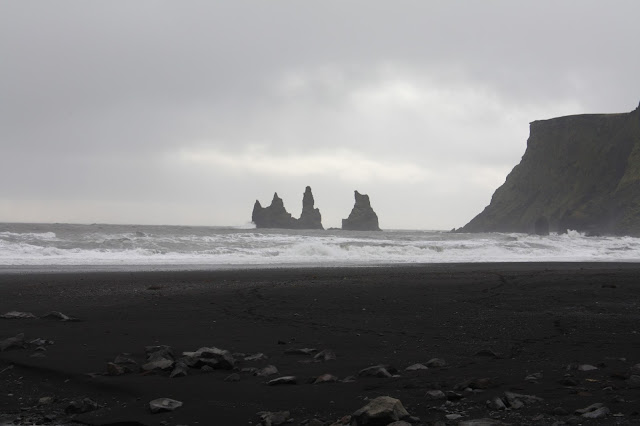 Basalt stacks Reynisdrangar at the black sand beach in Vik, Iceland.