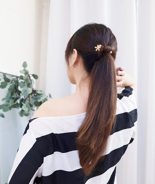 A photo of Simple ponytail for wedding guests.