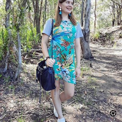 awayfromblue Instagram | floral print tee dress chunky sneakers dangly earrings rebecca minkoff regean bag