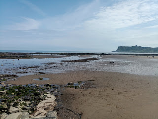 Photo of Scarborough's north bay from Scalby Mills to the Sands. The tide is right out, exposing all the rocks.