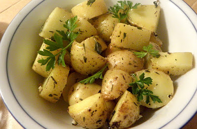 Overhead view of serving bowl of herbed potatoes