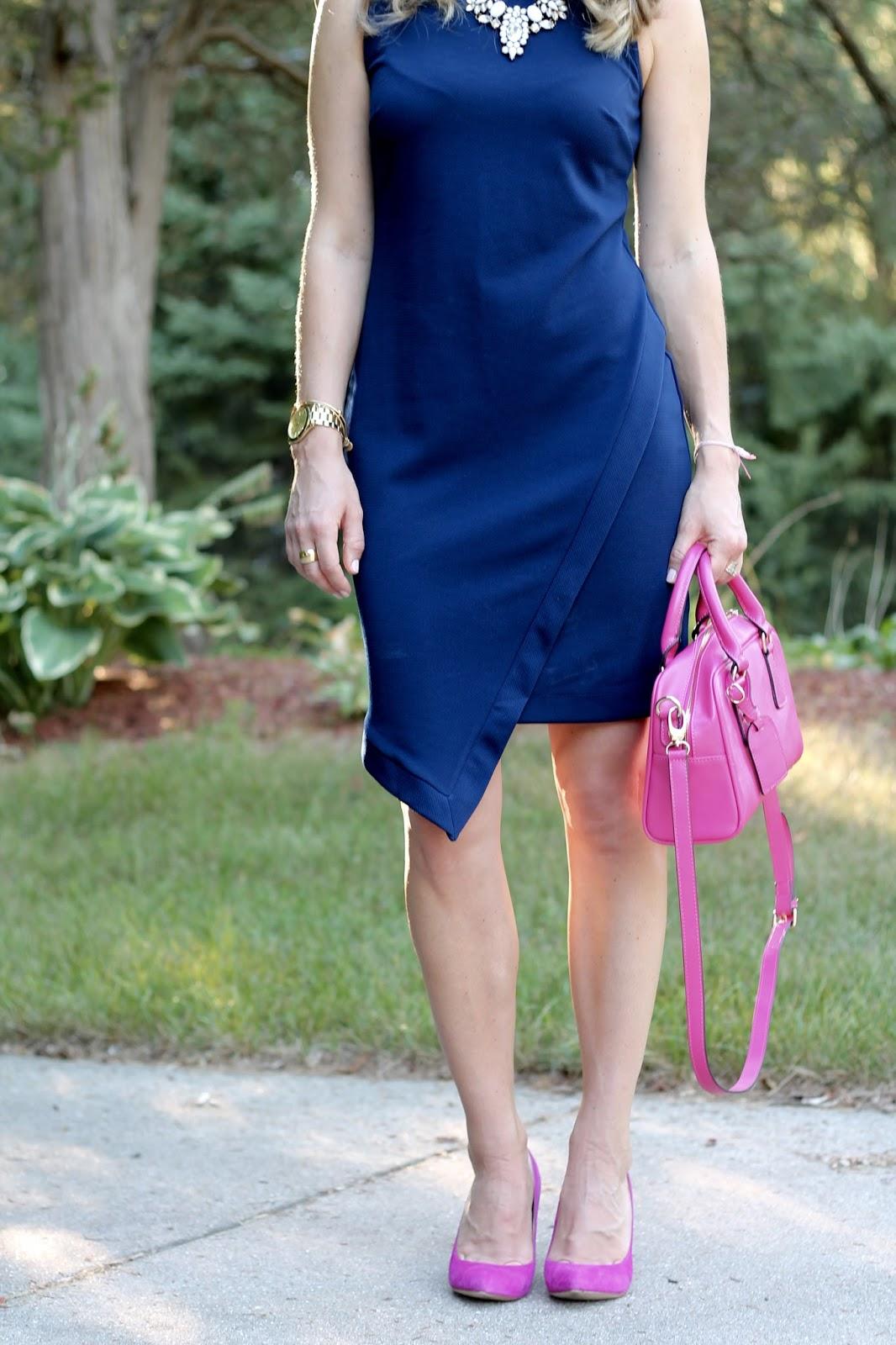 sleeveless navy envelope dress, pink heels, pink bag, white statement necklace,