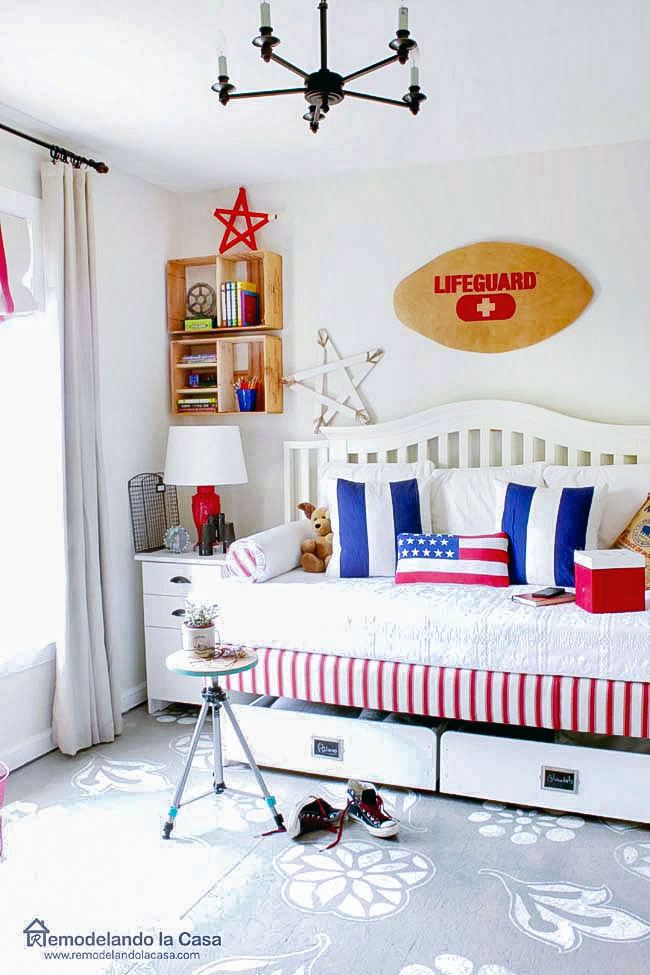 Red, white and blue bedroom with Lifeguard wall art and thrifty finds decor