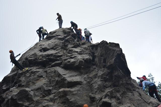 trainees doing rock climbing at tenzing rock, darjeeling