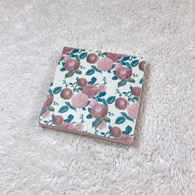 A canvas with scrapbook paper on it.