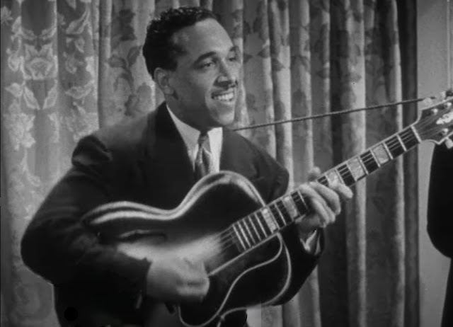 Oscar Moore plays his guitar in a soundie from 1944 of the King Cole Trio with Ida James