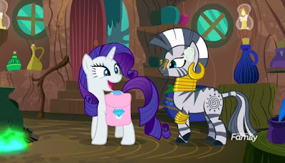 Rarity and Zecora (with clothes pegs on nose) in Zecora's hut