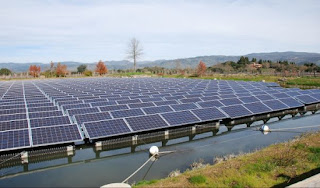 Floating solar panels on an irrigation pond at the Far Niente Winery in Oakville, California. (Credit: Far Niente Winery/UC Riverside) Click to Enlarge.