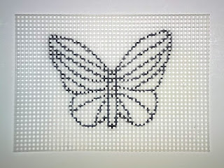 Butterfly drawing on plastic canvas