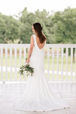 bridal portraits with unique wedding dress back