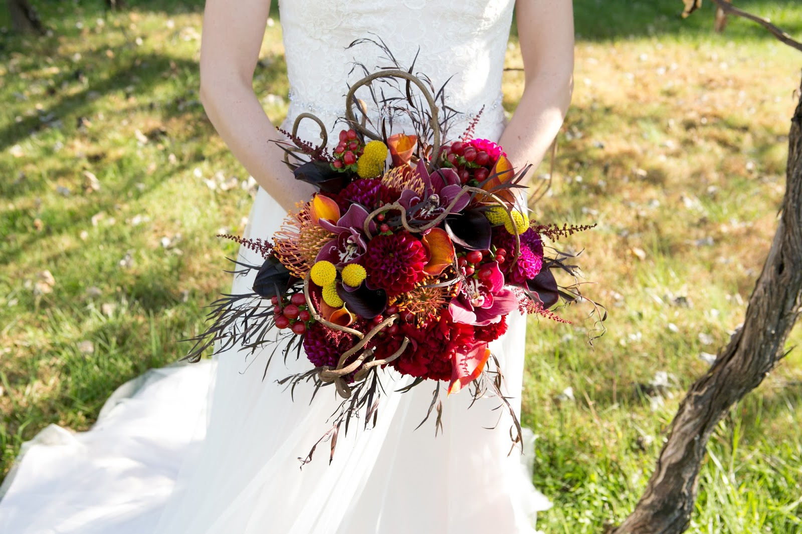 A wine inspired fall wedding sweet blossoms the boutonnieres were created with dark purple and orange calla lilies craspedia and red hypericum berries i used a little bit of greenery and tied them izmirmasajfo