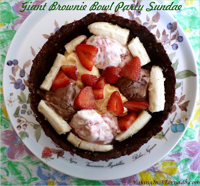 Giant Brownie Bowl Party Sundae is a sweet sharable treat for any group. Make the brownie bowl ahead, then fill, serve, and watch the fun. | Recipe developed by www.BakingInATornado.com | #recipe #dessert