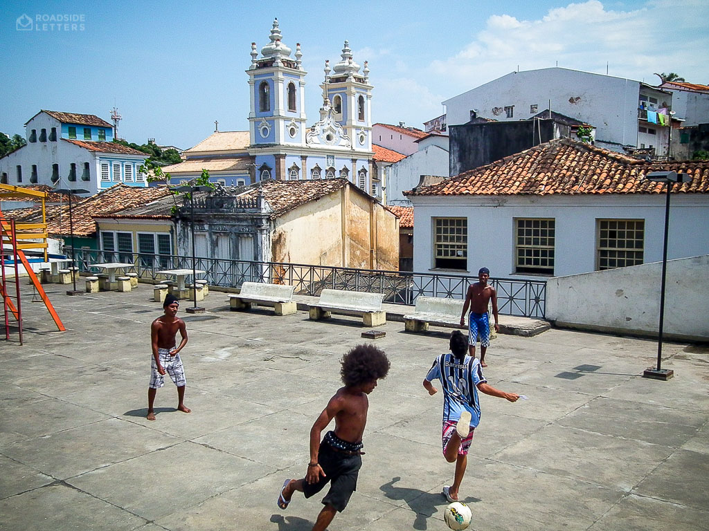 Kids playing football in Salvador, Brazil