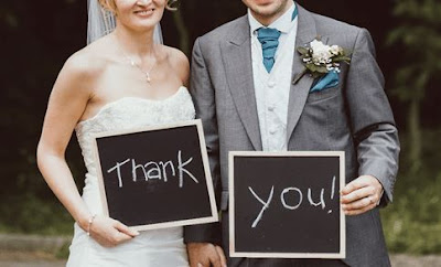 Image of couple holding thank you wedding anniversary wishes reply
