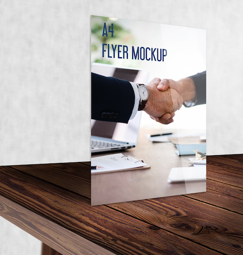 A4 Flyer mockup standing on wooden table