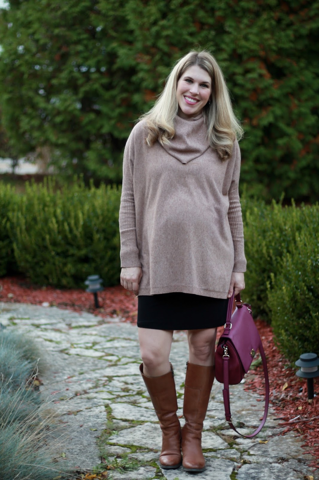 brown cowl neck sweater, black pencil skirt, cognac riding boots, plum Kate Spade bag, fall work maternity outfit