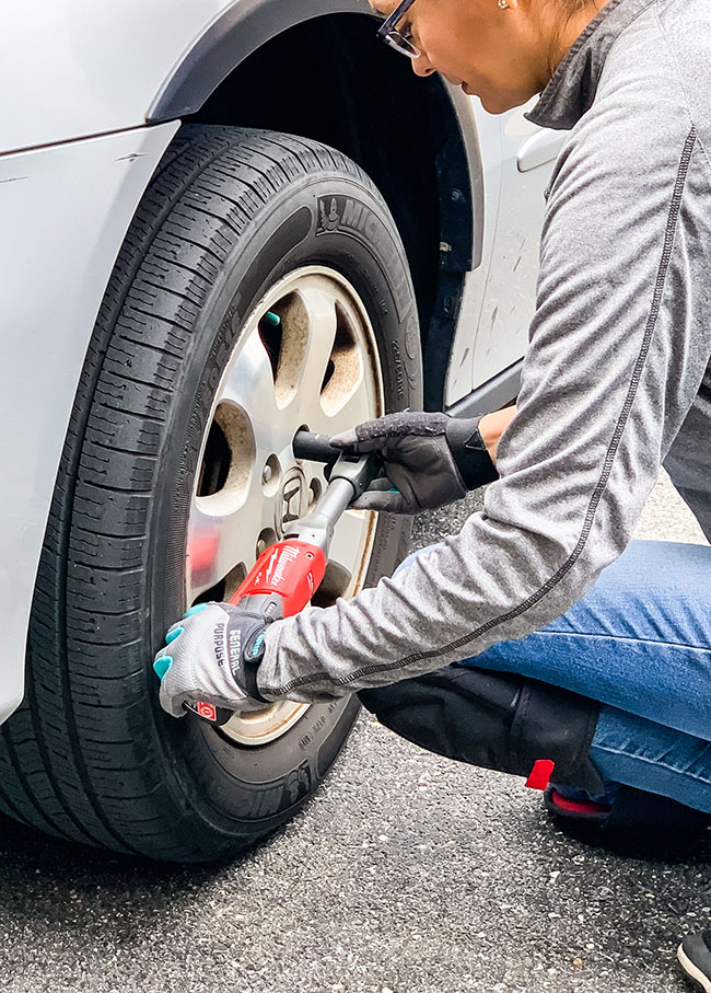 Cristina Garay - Milwaukee extended reach ratchet kit loosening nuts on car tires