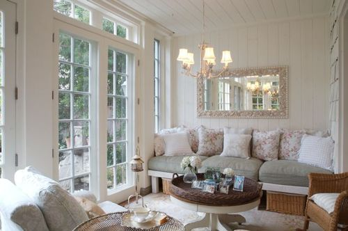 Romantic cottage style enclosed porch with shabby chic decor and furniture by Giannetti Home