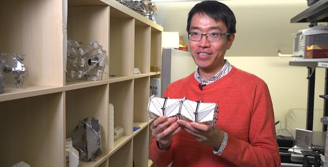 Jinkyu Yang and the paper model. Kiyomi Taguchi/University of Washington