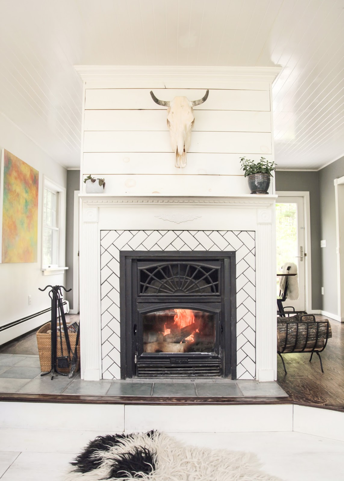 Modern Catskills Cabin Fireplace with Herringbone Tile