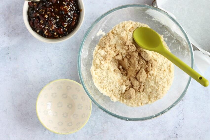 Mix sugar into crumble