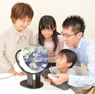 Image of the planet Earth is displayed with a father figure controlling the remote.