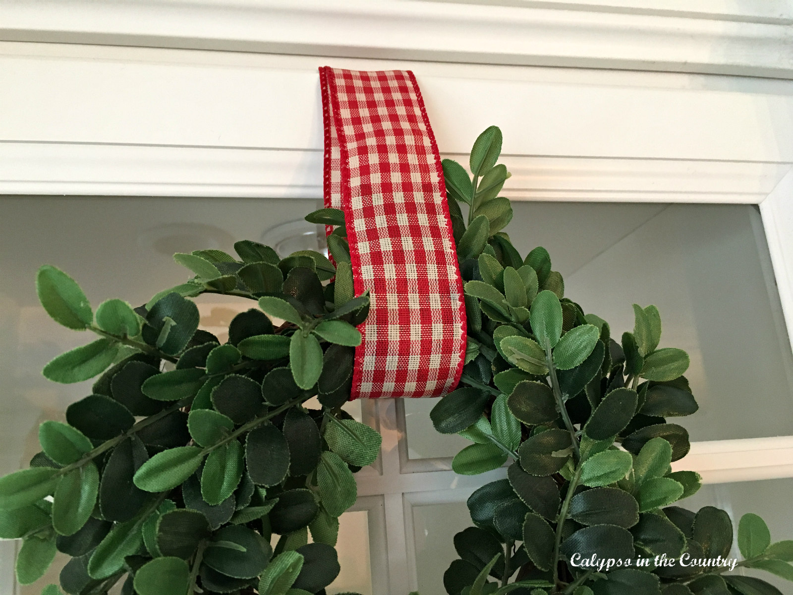 Mini Wreaths on Kitchen Cabinets