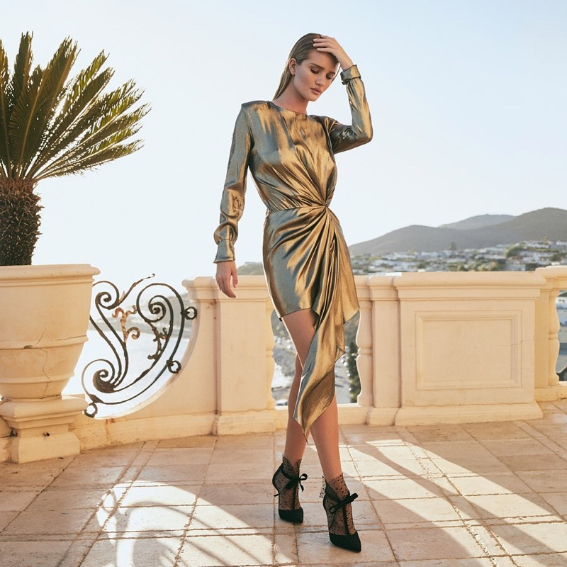 Rosie Huntington-Whiteley poses in Jimmy Choo's resort 2020 collection