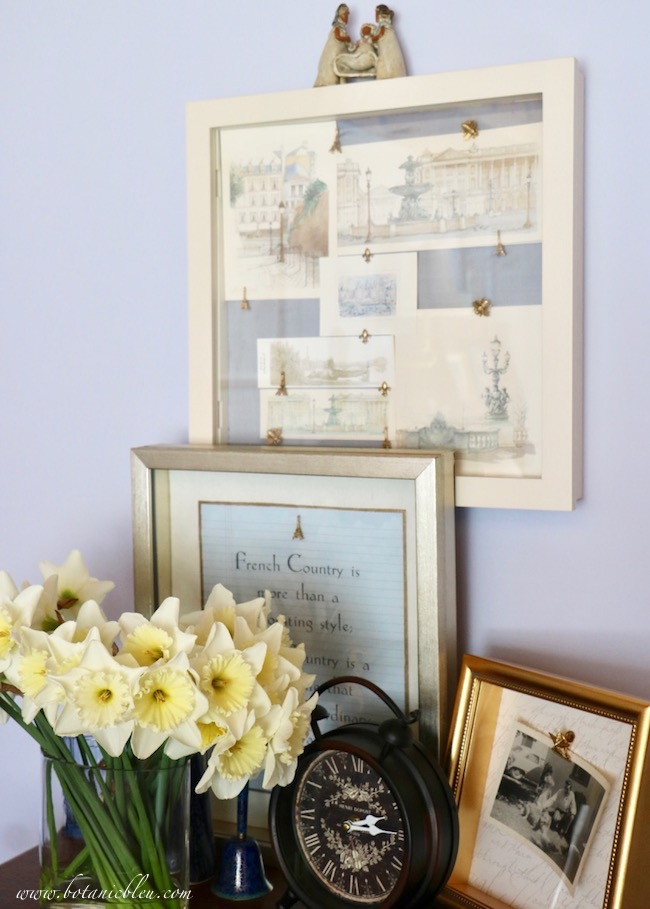 Layer shadowboxes atop a French antique chest of drawers