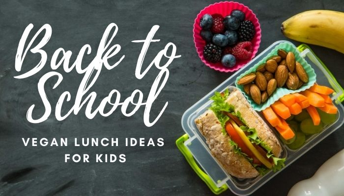 A kids lunch box with a salad roll, vegetables and fruit